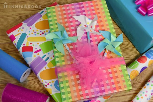 Create Pinwheels Out of Wrapping Paper for Party Favors
